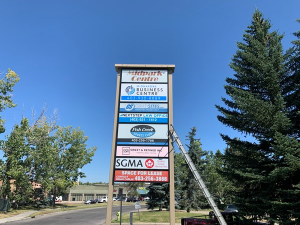 Exterior & Outdoor Signage - Polycarb white sign panel decorated with vinyl and then laminated for longevity!